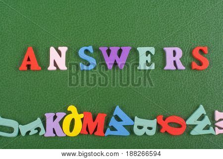 ANSWERS word on green background composed from colorful abc alphabet block wooden letters, copy space for ad text. Learning english concept