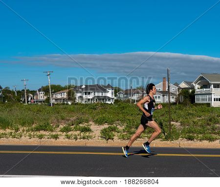 Spring Lake NJ USA -- May 27 2017 Runner takes an early lead in the annual Spring Lake 5 mile race. Editorial Use Only.