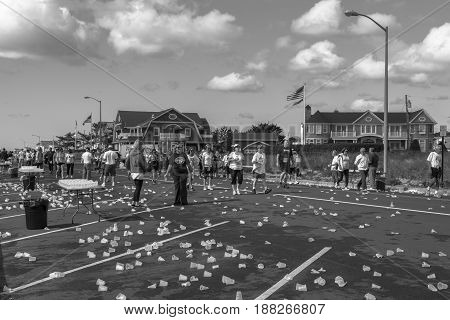 Spring Lake NJ USA -- May 27 2017 A trail of discarded water cups on the street as the race begins to wind down. Editorial use only.