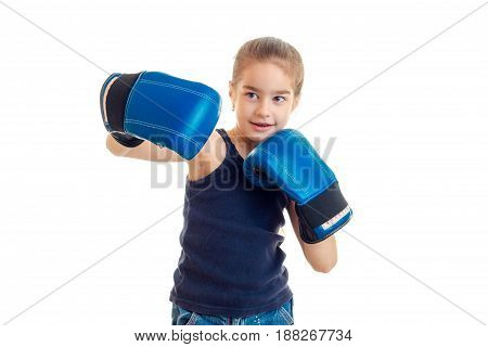 young sports girl practicing boxing in blue gloves isolated on white background