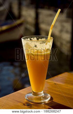 orange juice in Glass on wodden table