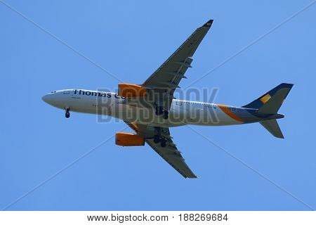 NEW YORK - MAY 20, 2017: Thomas Cook Airlines Airbus A330 descends for landing at JFK International Airport in New York