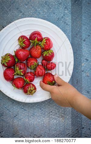 Ripe strawberries in a plate In rustic style