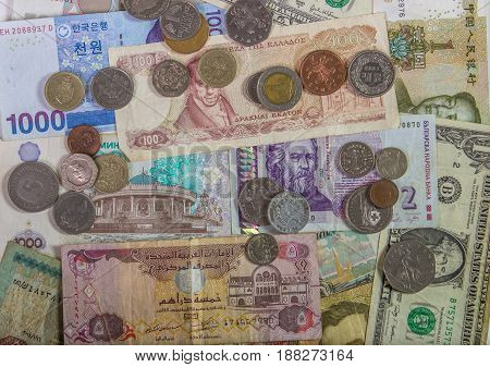 Colorful Background Of Many Currency Banknotes.