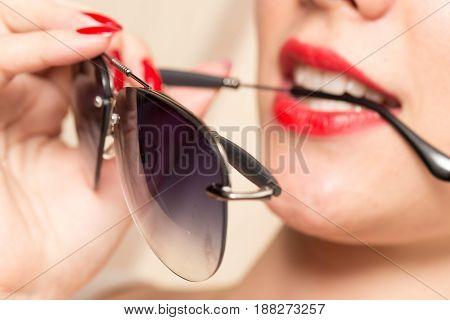 A Sunglasses in the teeth . A photo