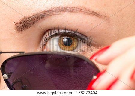 sunglasses and eye. A close . A photo
