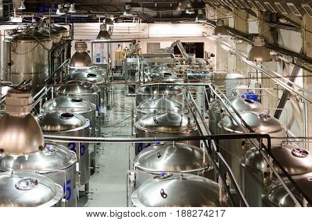 A workshop for the production of beer. A lot of metal tanks.