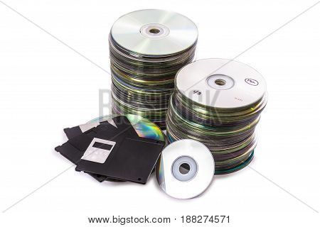 Heaps of Old Fashion cd disk floppys and mini dics. Isolated over white background