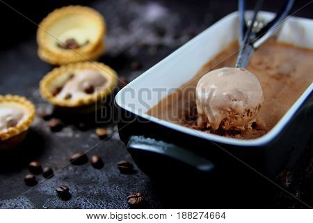 coffee ice cream in a metal spoon