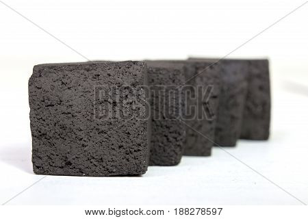Group Of Charcoal Cubes Isolated On White Background