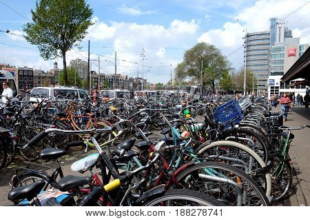 AMSTERDAM NETHERLANDS - MAY 14 2017: Bicycle parking in the center of Amsterdam