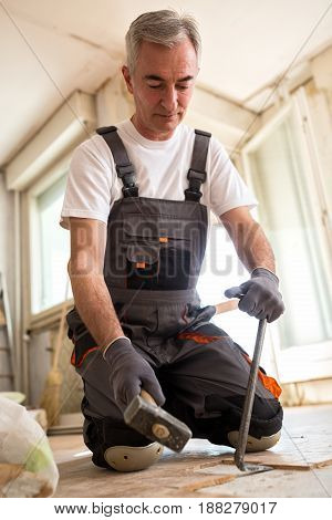 Senior Man Removed The Old Parquet In The Reconstruction Of The Building