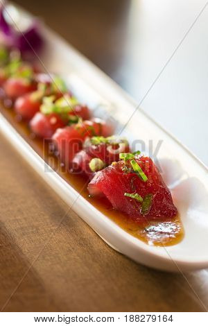 Tuna sashimi is a delicious japanese cuisine dish consisting of thinly sliced fresh raw fish in japan it is often served as appetizer in restaurants. Salmon or other meat can be used instead of tuna.