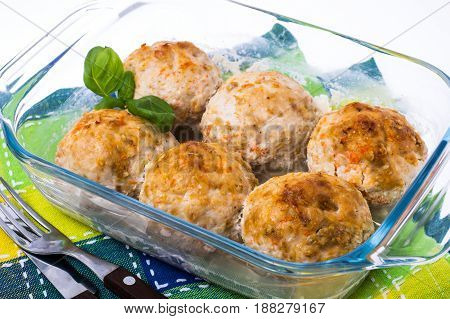 Grilled meatballs in  glass  frying pan. Studio Photo
