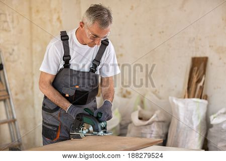 Senior Worker In The Carpentry Workshop