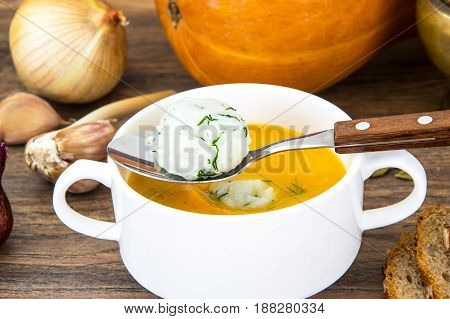 Dietary soup puree with rice, carrots and pumpkin. Studio Photo
