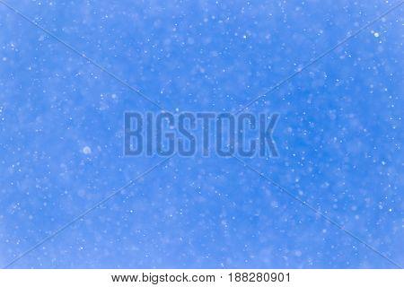 snowing on a blue sky . A photo
