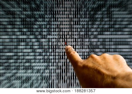 Finger Pointing At A Red Bit In Binary Code