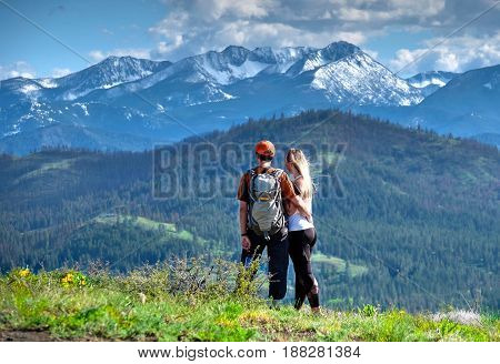 Happy friends hipsters hiking in mountains. North Cascades National Park. Cascade Mountains. Winthrop. Washington. The United States.