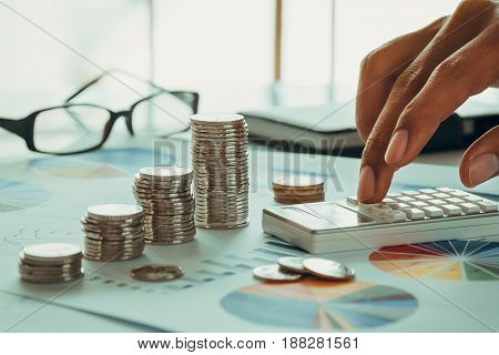 Financial analysis concept with coins, chart, calculator and eyewear