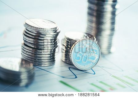 Financial business concept with coins and business graph