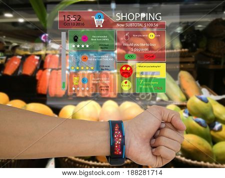 iotinternet of things marketing conceptman wear a smart watch with augmented reality technology to see the data which recommended by retailthe application show subtotalrecommended search engine