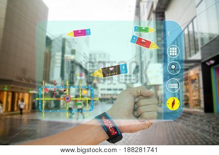 iot internet of thingsconcept man use smart watch with augmented reality technology to show how farratio of voteand how many people like by applicationwhile travel