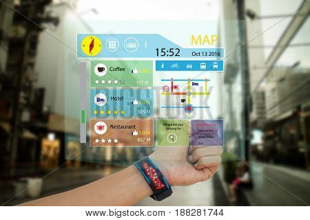 iot internet of thingsconcept man use smart watch with augmented reality technology to show the map recommended place with review including likeratio of voteand transport vehiclewhile travel