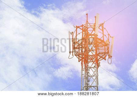 Atenna telecommunication tower against the blue sky background