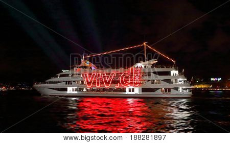 SYDNEY AUSTRALIA - MAY 26 2017; Boats cruise the harbour taking passengers and tourists to see the harbour city during Vivid Sydney annual event of light music and ideas