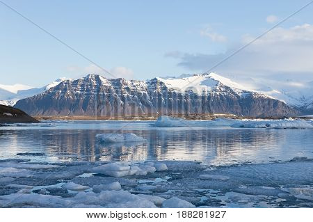 Vocalno rock mountain over winter lagoon Iceland winter natural landscape background