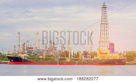Oil transportation ship over refinery factory background water front