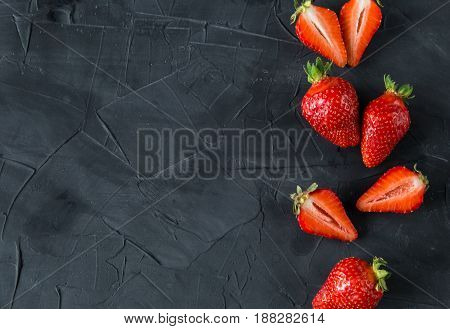 Fresh strawberries on concrete background. top view. space fot text