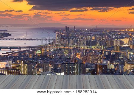 Opening wooden floor Sunset over Osaka city downtown and river Japan cityscape downtown background
