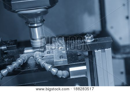 The CNC milling machine cutting the sample part with the small end-mill in light blue scene.Hi-precision CNC machining concept.