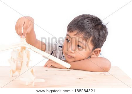 Cute asian little boy play plane toy wood