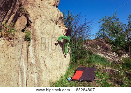 Climber Is Bouldering Outdoors.