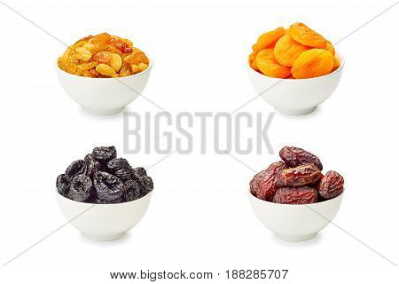 Set of bowls with dried fruits isolated on white background