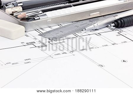 Ruler, Eraser And Pens On Graphical Blueprints Of House Interior