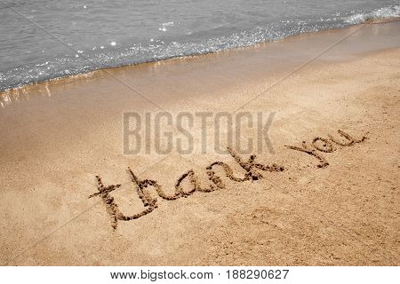 Thank You message left in a sandy beach
