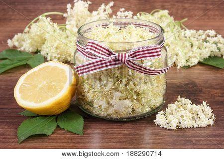 Elderberry Flowers And Lemon For Preparing Fresh Healthy Juice On Board, Concept Of Alternative Medi