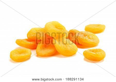 Heap of dried apricots isolated on white background