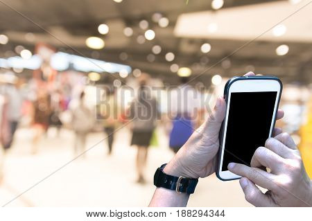 Using smartphone in shopping mall. Smart Shopping