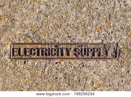 Electricity Supply mark sign on foot path of London England