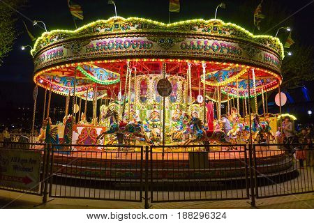 London England - 10 April 2017 - Merry Go Round carousel waits for its customers at night in London England on April 10 2017.