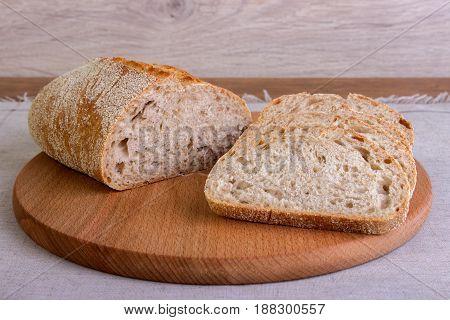 Fresh Bread Sliced On A Wooden Board