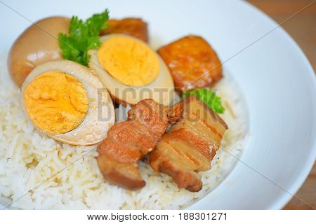Rice and egg and pork in brown sauce,Thai food