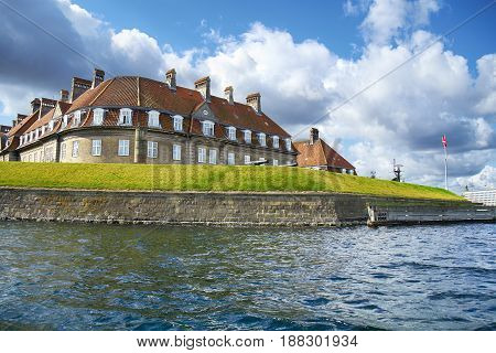 The Red Roof House Near A Channel.
