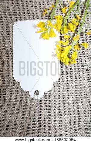 Woven fabric with a card and yellow flowers