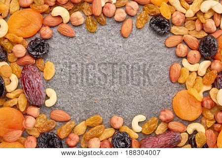 Mix of dried fruits and nuts with text space. Background concept